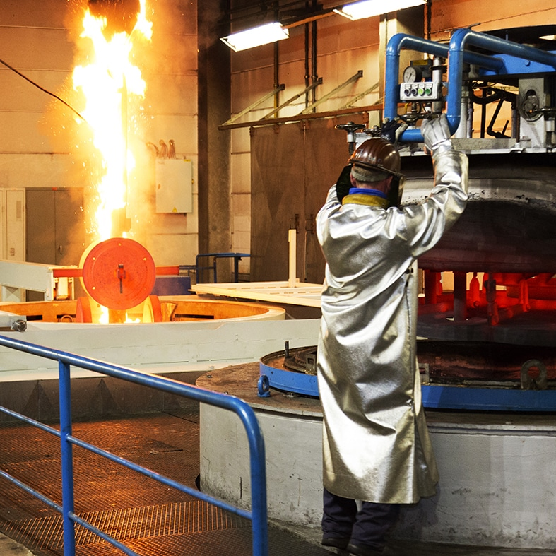 Worker is busy with heat treatment in a safe outfit